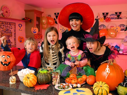 Family dressed up in halloween costumes for a home halloween party