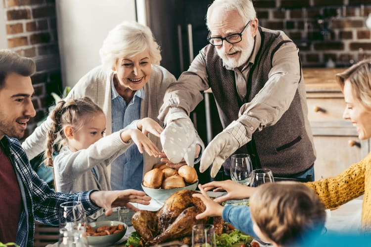Family discussing Thanksgiving Facts around dinner table