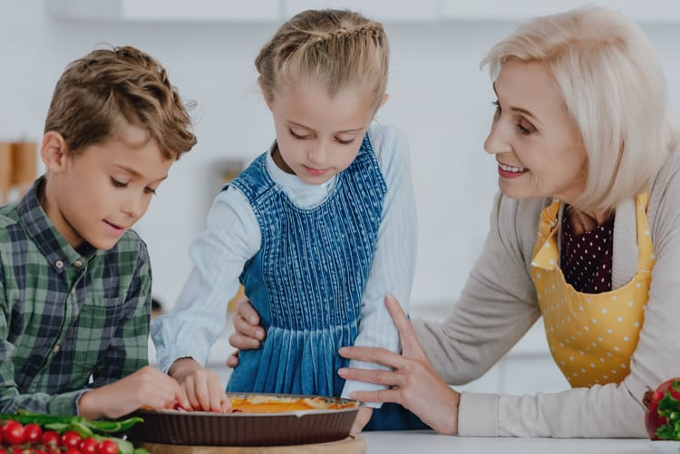 Grandma and grandkids making pie based on Thanksgiving Facts
