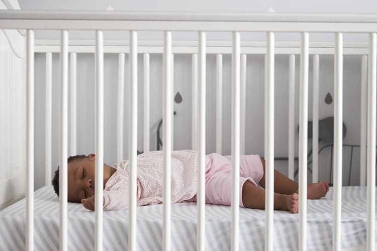 baby asleep in a crib