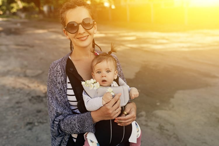 mom with baby in baby carrier in miami