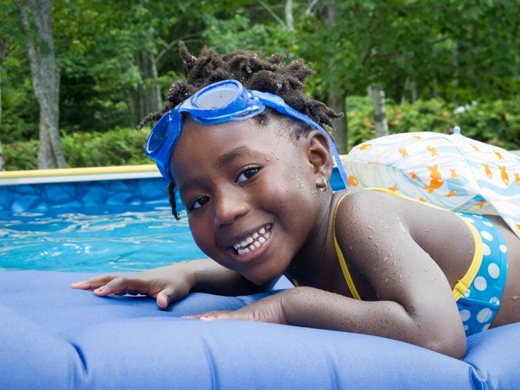 child swimming in miami
