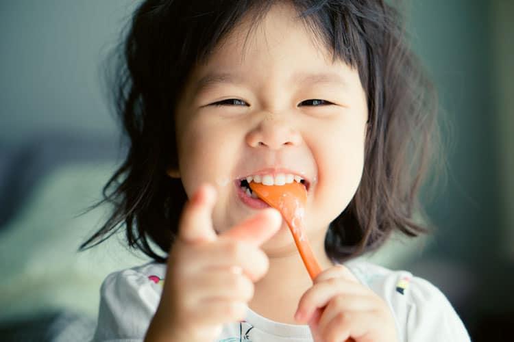 happy girl eating in atlanta
