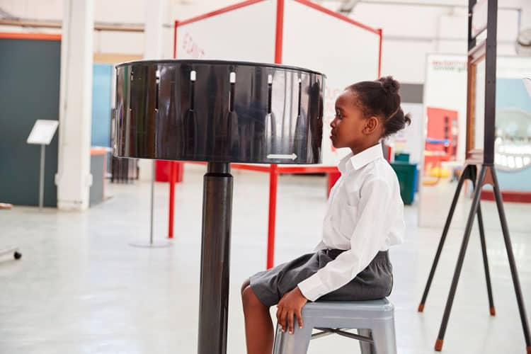 girl watching zoetrope at children's museum