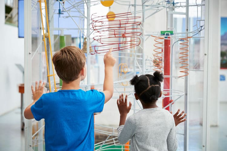 boy and girl enjoying children's museum