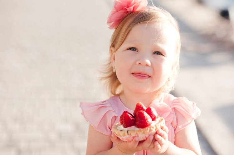 little girl with pie from pie shop