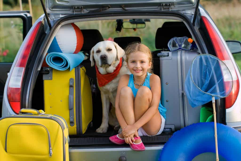 girl in well packed car for ready for road trip