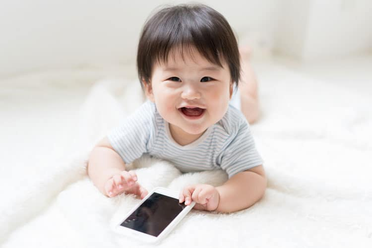 baby playing on iphone