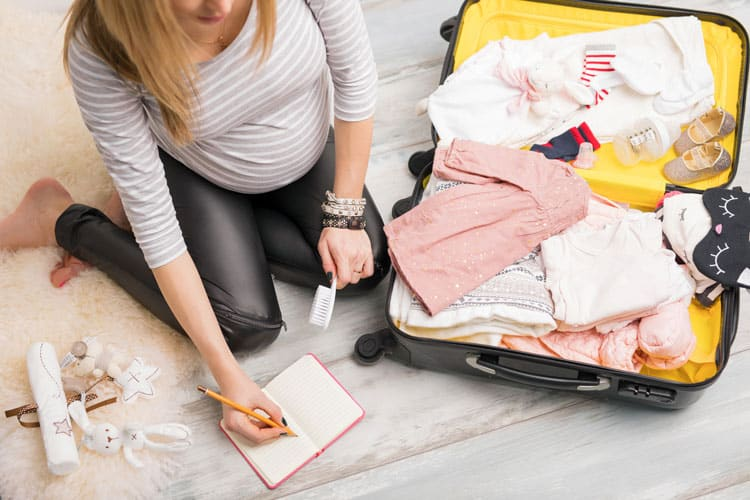 expecting woman packing for a trip