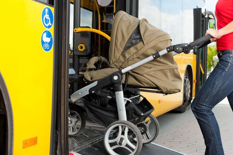 mom loading stroller onto a bus