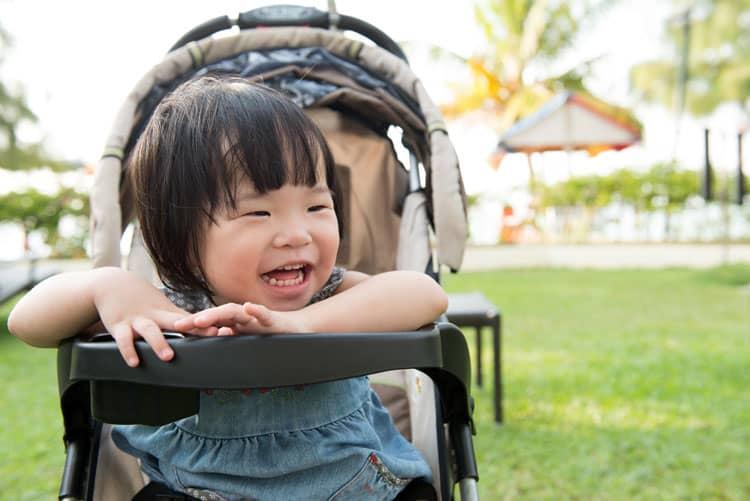 asian girl sitting in stroller