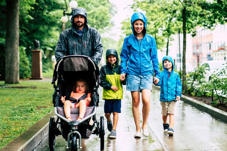 family walking in the rain with a stroller to Disney World
