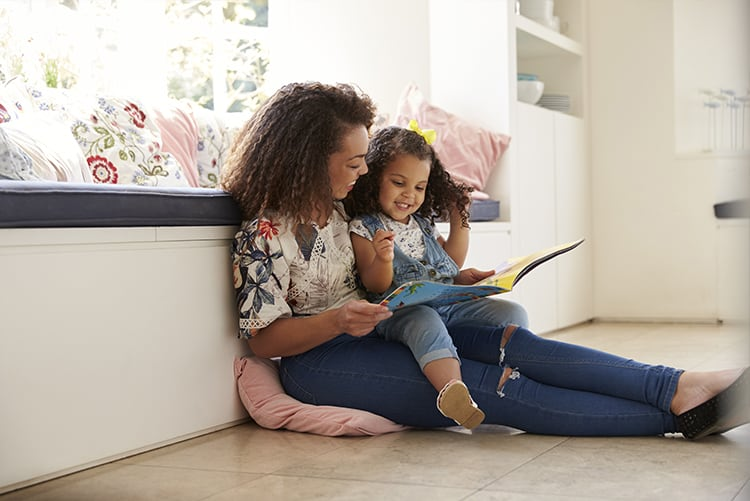 mom reading to her daughter