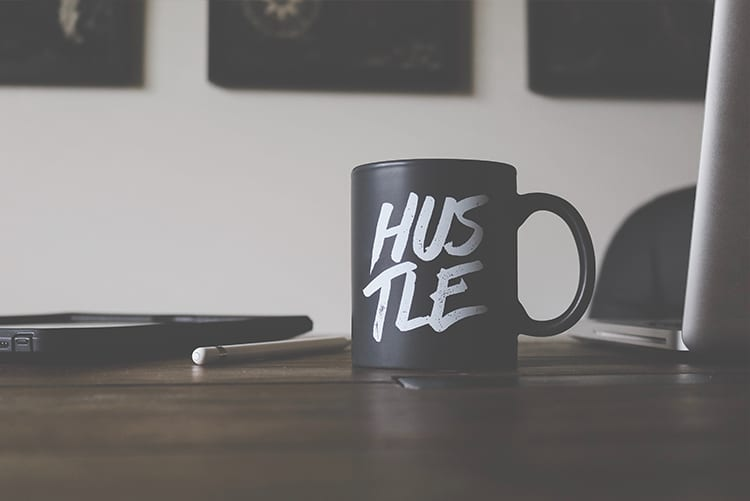 mug with hustle on it