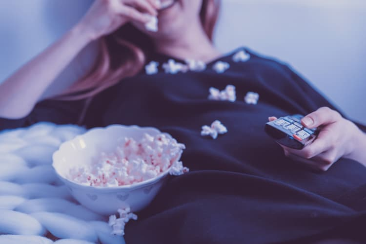 mom eating popcorn and laughing