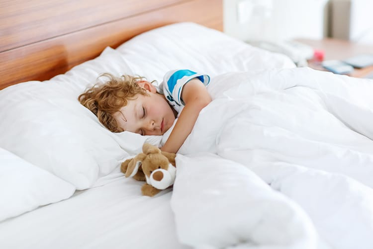 child resting peacefully after overcoming baby sleep problems