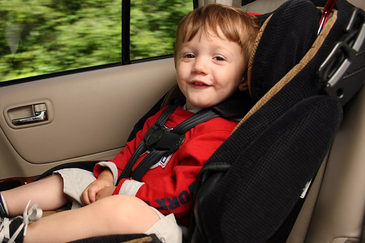 toddler riding in a car seat