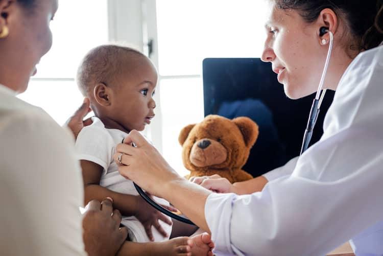 pediatrician checking on small boy
