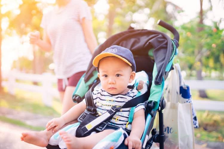 baby boy sitting in stroller