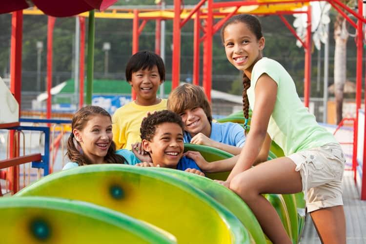 children on an amusement park ride