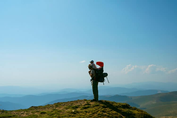father hiking with child in mountains
