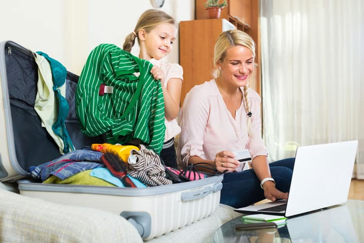 mother and daughter packing for a family travel vacation