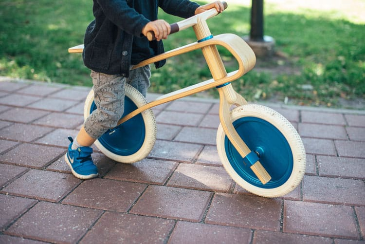 child on balance bike