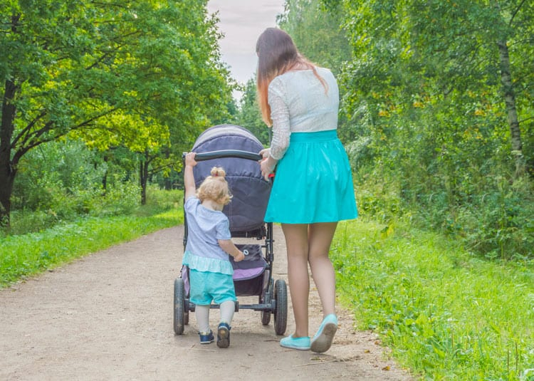 toddler walking with mother for physical activity