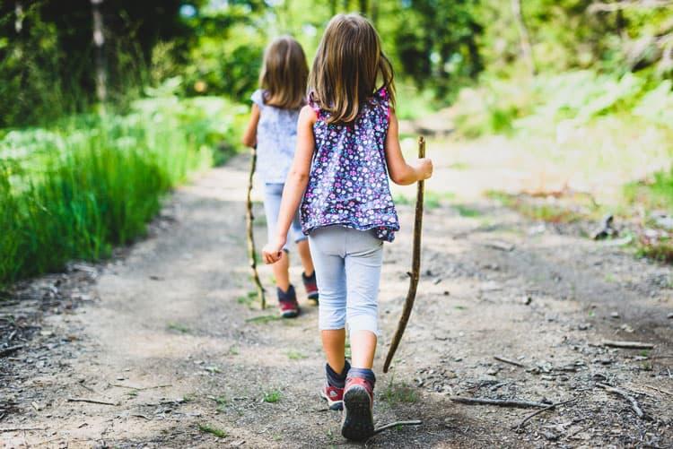 girls hiking in Raleigh with walking sticks