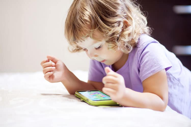 child playing on phone