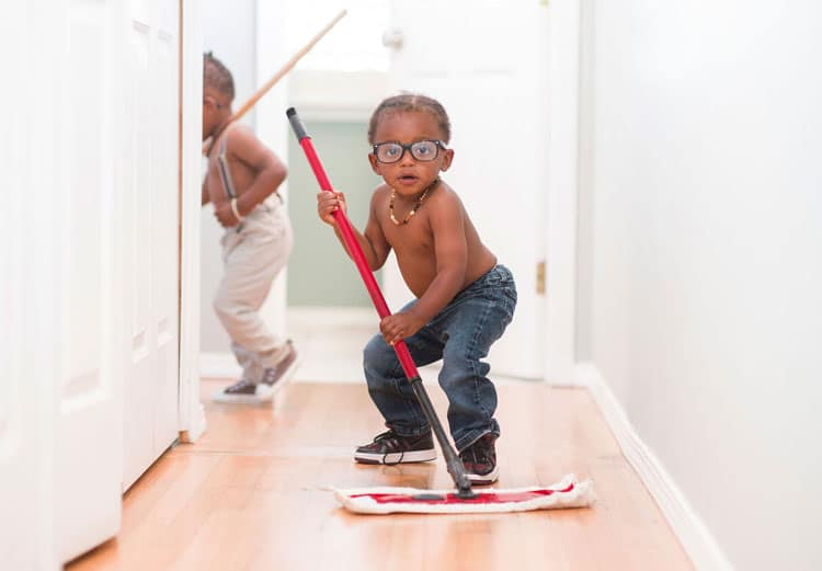 child cleaning up for holiday preparation