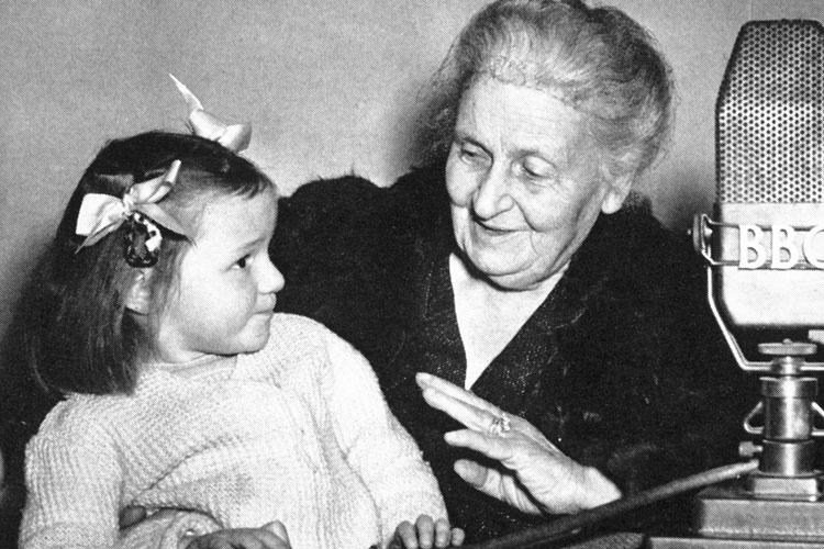 maria montessori with small child