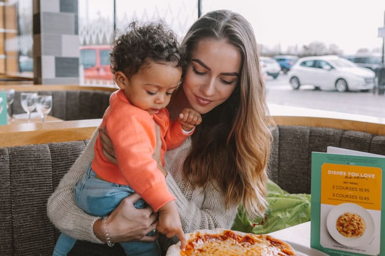 mom eating with adopted child during national adoption month