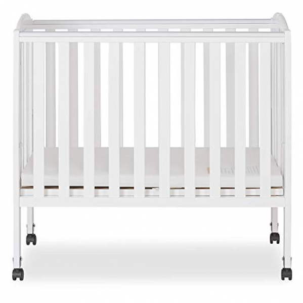 mini crib with linens