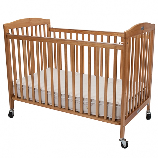 Compact Wooden Crib with Linens