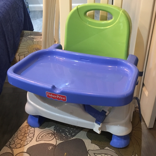 Fisher price travel booster/high chair with tray
